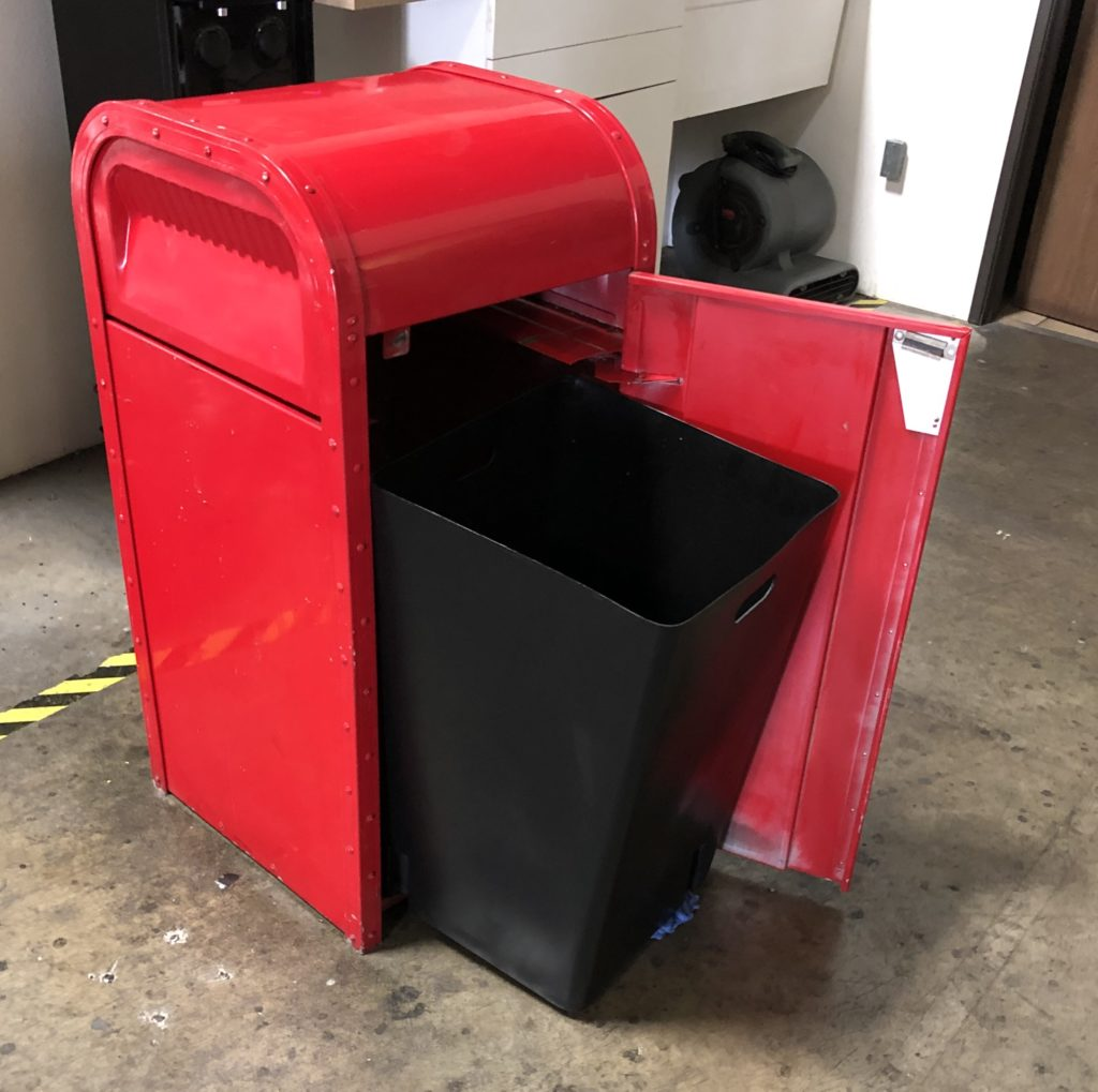 black square trash liner in red trash can